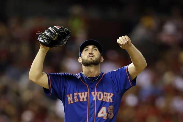Mets starting pitcher Jonathon Niese stretches on the