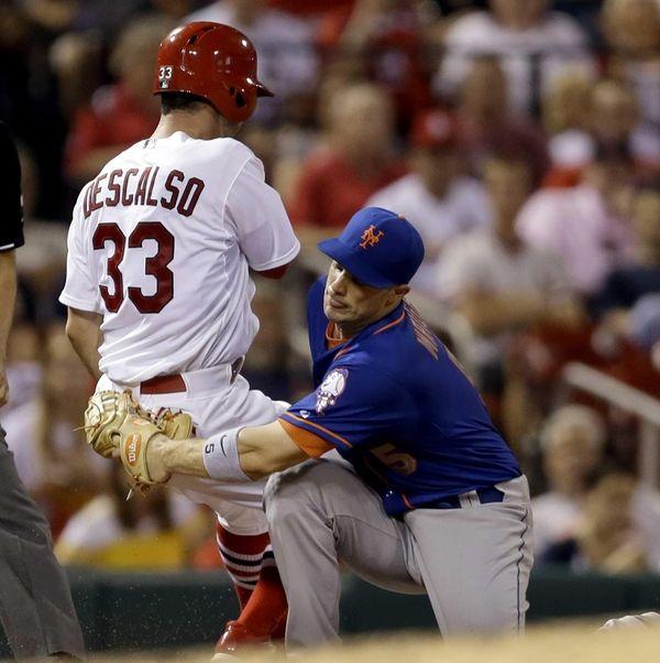 St. Louis Cardinals' Daniel Descalso, left, is able