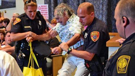 A man identified as Huntington resident Daniel Karpen
