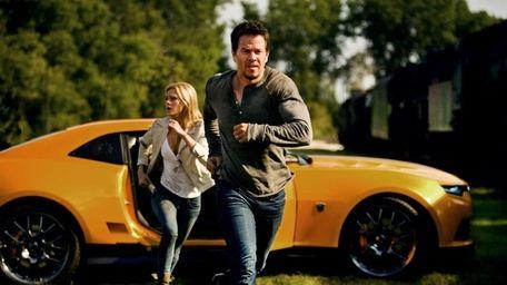 Nicola Peltz as Tessa and Mark Wahlberg as