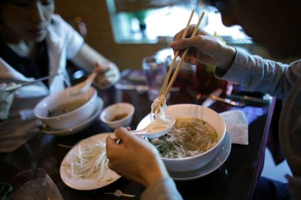 The namesake rice noodle soup, pho, is served