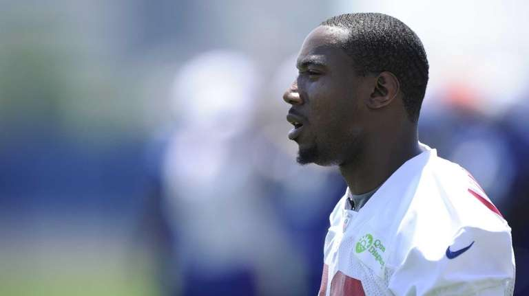 Giants wide receiver Mario Manningham looks on from