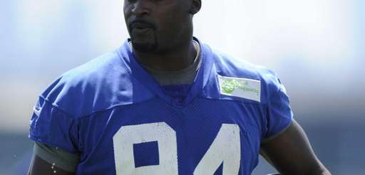 Giants defensive end Mathias Kiwanuka looks on from