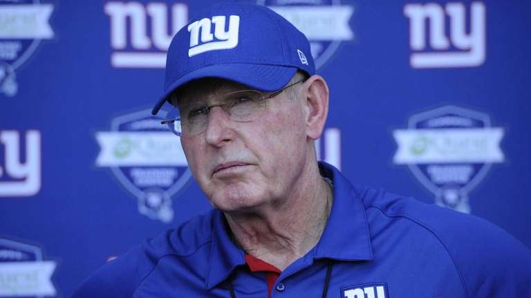 Giants head coach Tom Coughlin answers questions from
