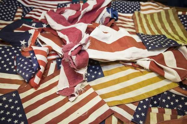 Weathered and tattered flags collected at American Legion