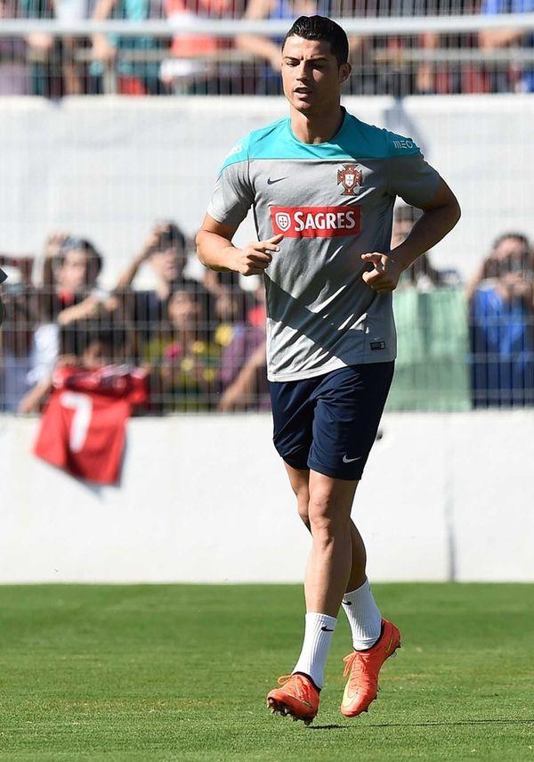 Portugal forward Cristiano Ronaldo runs during a training