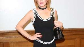 Lindsay Lohan attends the Moschino show during the