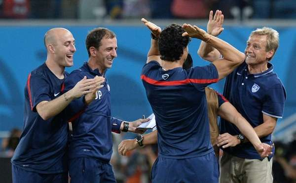 U.S. coach Juergen Klinsmann, right, celebrates with teammates