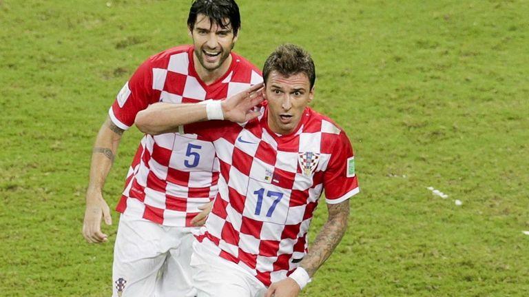 Croatia's Mario Mandzukic (17) celebrates with his teammate