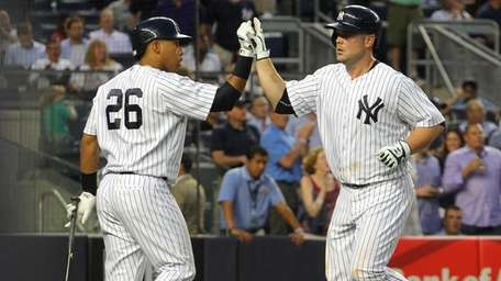 Yangervis Solarte congratulates Brian McCann after McCann's two-run