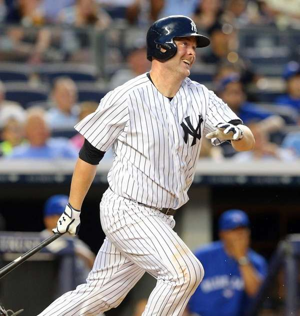 Yankees catcher Brian McCann hits a two-run home