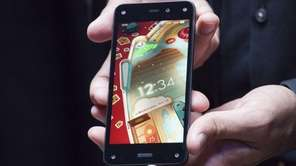 Amazon.com's first smartphone, the Fire Phone, is displayed