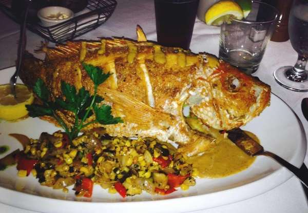 Crisp, whole red snapper highlights the menu at