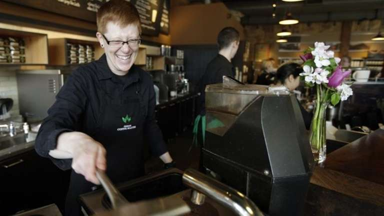 Starbucks barista Linsey Pringle prepares a cup of