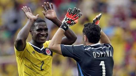 Colombia goalkeeper David Ospina, right, and Colombia's Cristian