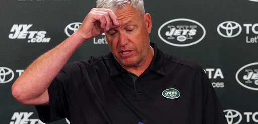Jets head coach Rex Ryan talks to the
