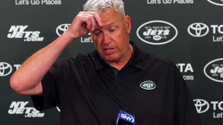 Jets head coach Rex Ryan talks to the