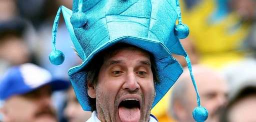 A Uruguay fan takes a selfie before the