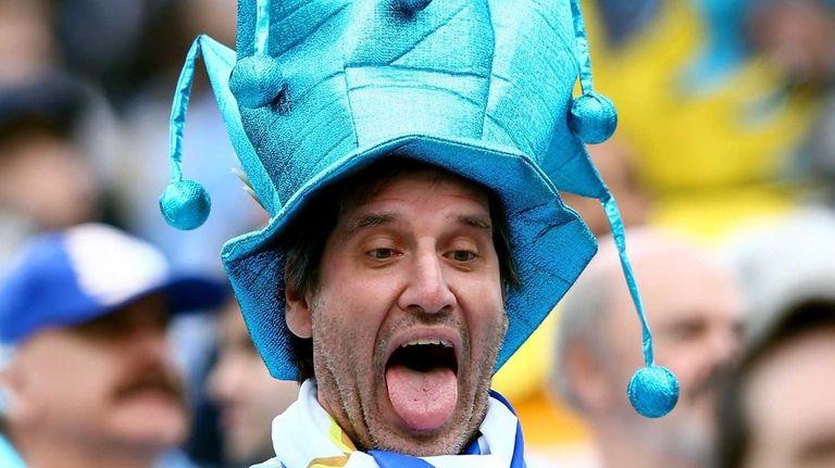 A Uruguay fan takes a selfie before the