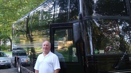 Jack Byrnes with the limousine bus he drives