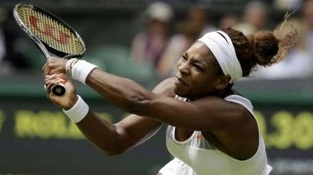 Serena Williams of the United States returns to