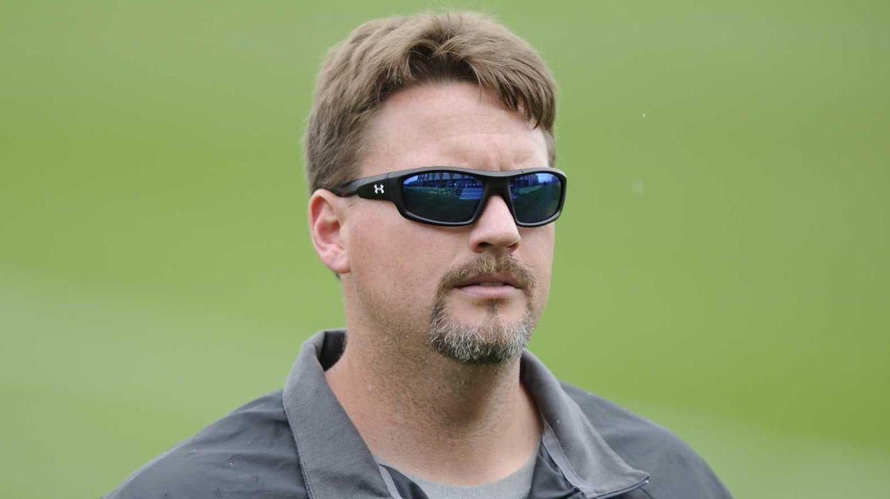 New York Giants offensive coordinator Ben McAdoo walks