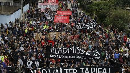 Protesters march along Reboucas Avenue in Sao Paulo,