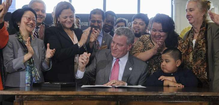 New York City Mayor Bill de Blasio signs