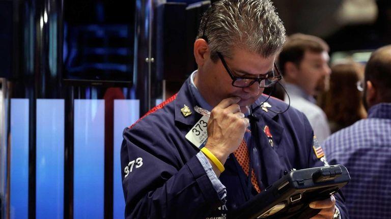 Trader John Panin works on the floor of