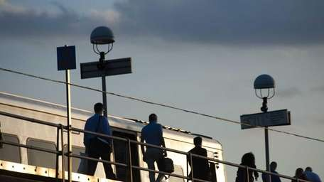 Commuters on the platform of the Rockville Centre