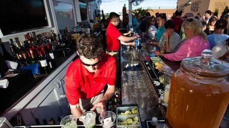 Erik Ventuleth, of Rockville Centre, serves drinks at