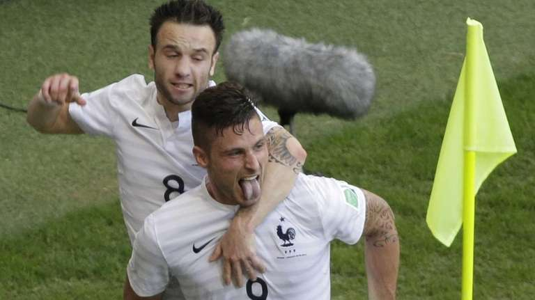 France's Mathieu Valbuena, left, celebrates with his teammate