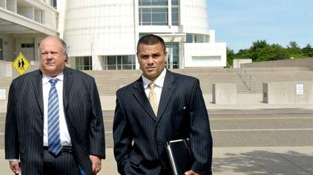 Bryan Arias, right, and his lawyer Richard A.