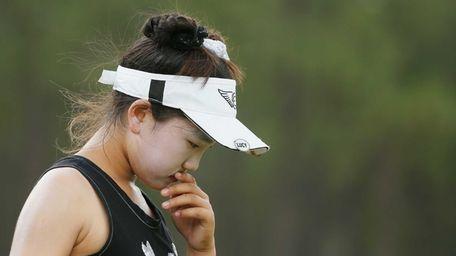 Lucy Li, 11, of the United States walks