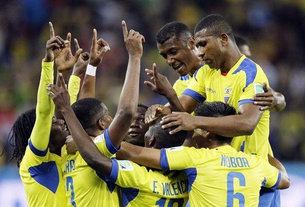 Ecuador's Enner Valencia, center, celebrates with teammates after