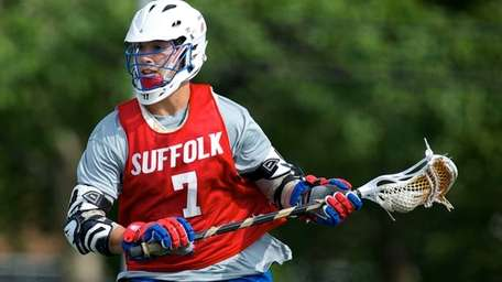 Suffolk All-Star Jake Buonaiuto (7) handles the ball