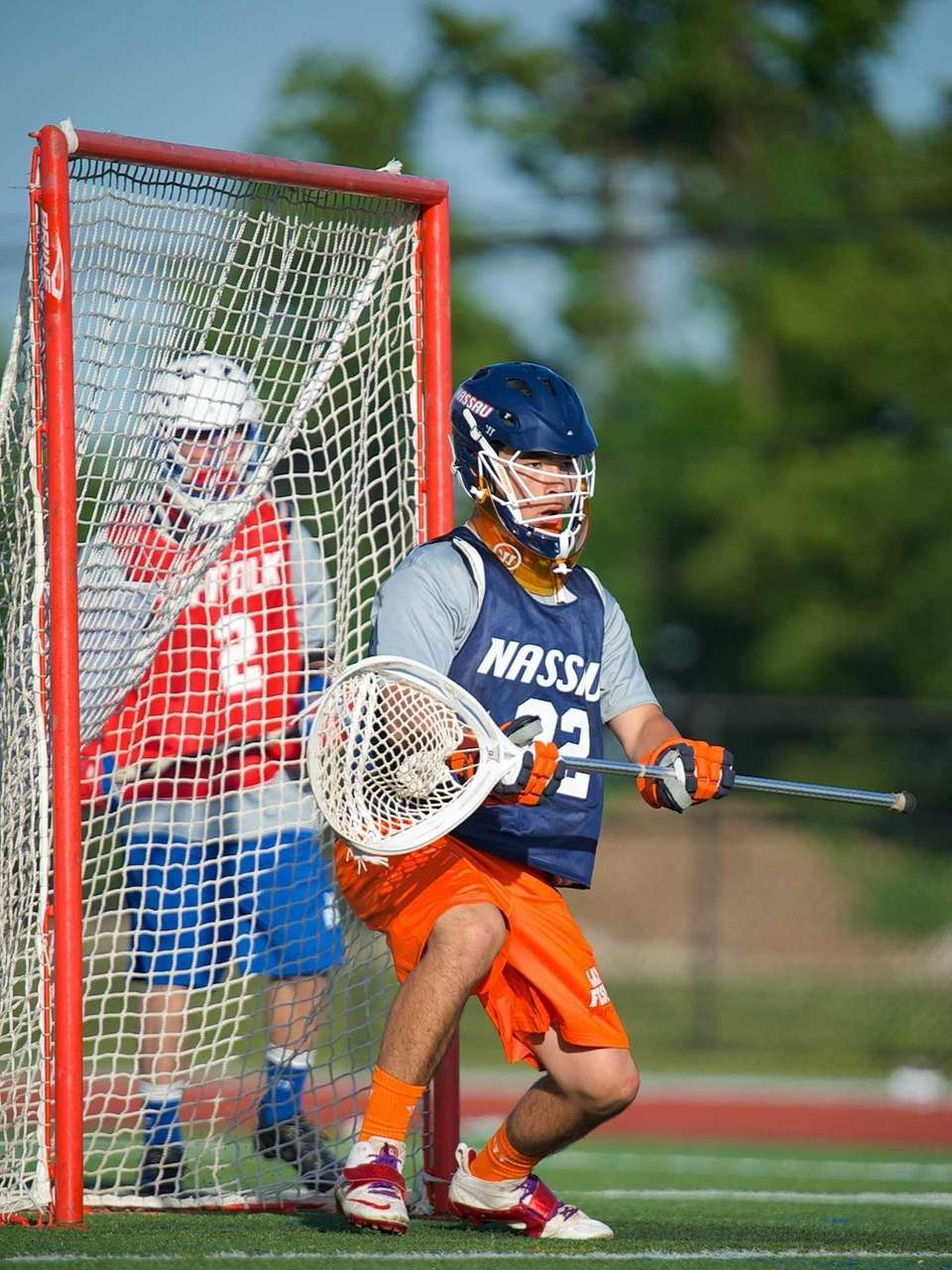 Nassau All-Star Goalie Gavin Tam (22) attempts to