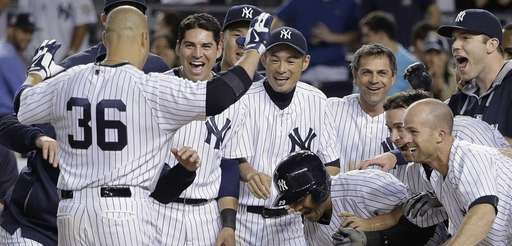 Yankees designated hitter Carlos Beltran (36) is greeted