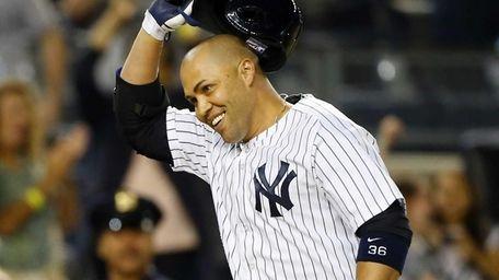 Carlos Beltran of the Yankees celebrates his game-winning