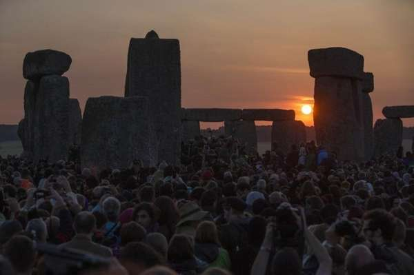 The sun rises as thousands of revelers gathered