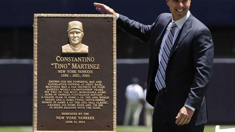 Former Yankees player Tino Martinez reacts as he