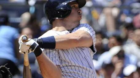 The Yankees' Mark Teixeira homers against the Baltimore