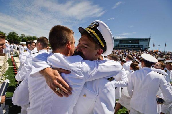 Midshipman Dustin Myers of Merritt Island, Florida, hugs