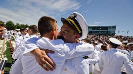 Midshipman Dustin Myers of Merritt Island, Florida, hugs