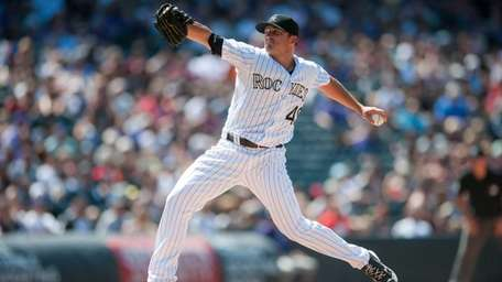 Rex Brothers of the Colorado Rockies pitches against