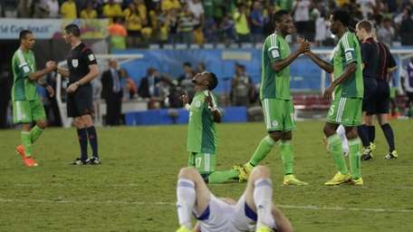 Nigeria celebrates after the Group F World Cup