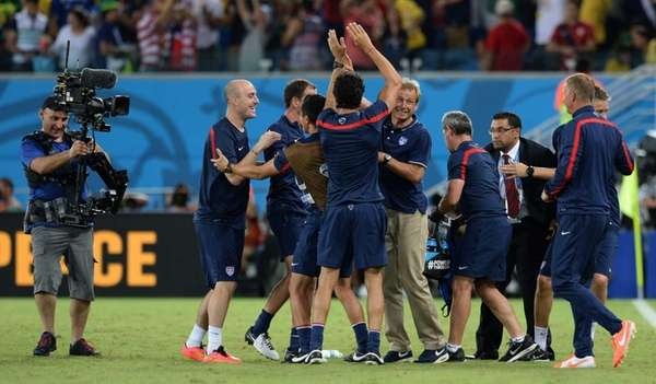 U.S. coach Juergen Klinsmann celebrates with his team