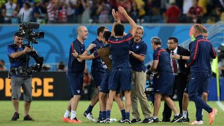 U.S. coach Juergen Klinsmann celebrates with his team
