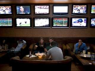 Dozens of flat-screen televisions surround the room where