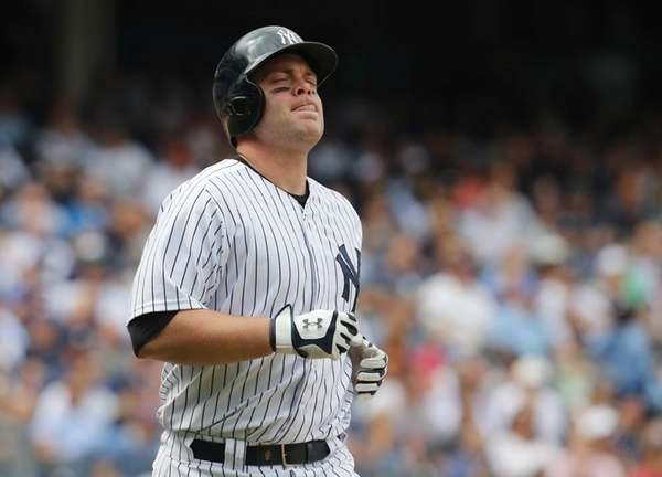 Brian McCann of the Yankees reacts after popping